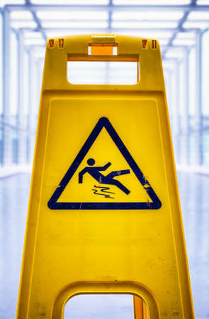 tripping: caution wet floor sign at a corridor