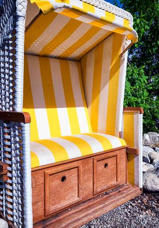 german north sea region: hooded beach chair at a back yard Stock Photo