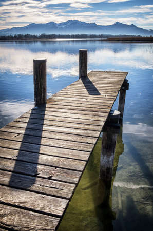 bollard: old wooden jetty at the chiemsee lake in bavaria