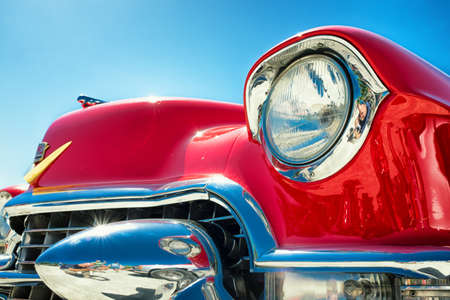 chrome: headlight of a oldtimer in front of blue sky Editorial