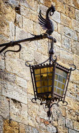 beautiful historic streetlamp and brick wall photo