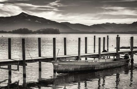 nature photography: old wooden jetty at the chiemsee lake in bavaria