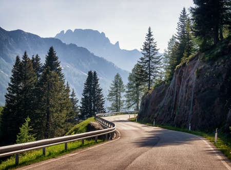 single lane road: country road at the european alps Stock Photo