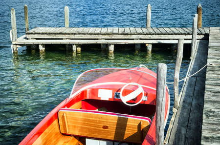 old boat at a jetty photo