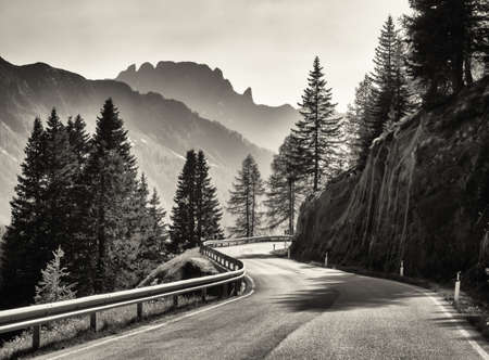 black and white photography: country road at the european alps Stock Photo