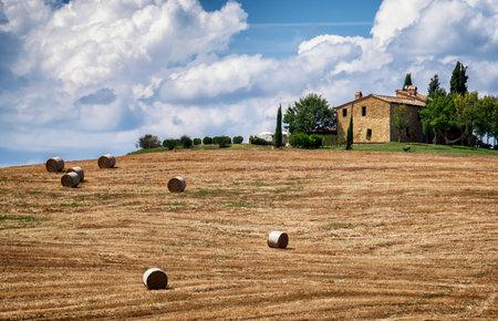 haybales at a field - tuscany - italy - photo