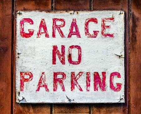 no parking: no parking sign at a garage