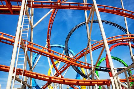 part of a roller coaster in front of blue sky 写真素材