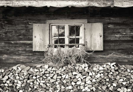 old window at a farm - firewood photo