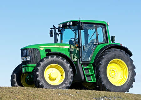 john deere: MUNICH, GERMANY - FEBRUARY 29 - A John Deere Model 6630 - new tractor at a field  at February 29, 2012 near munich - germany