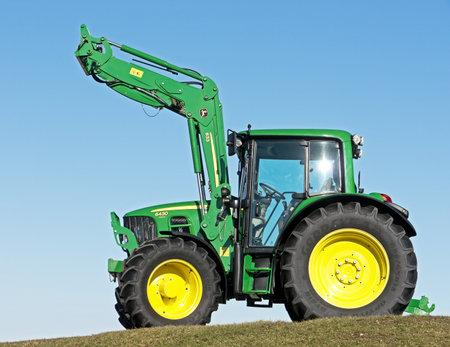 deere: MUNICH, GERMANY - FEBRUARY 29 - A John Deere Model 6430 new tractor  at February 29, 2012 at a field near munich - germany Editorial