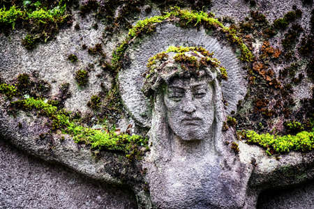 jesus face: old jesus christ relief at a historic gravestone