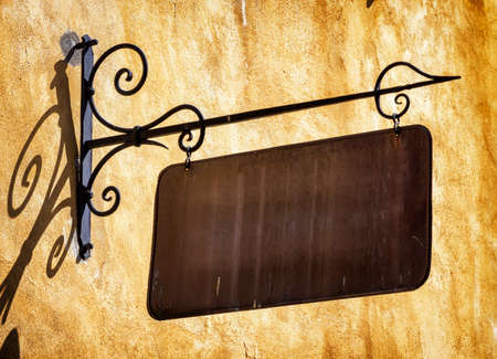 old sign: old ornate store sign - photo Stock Photo