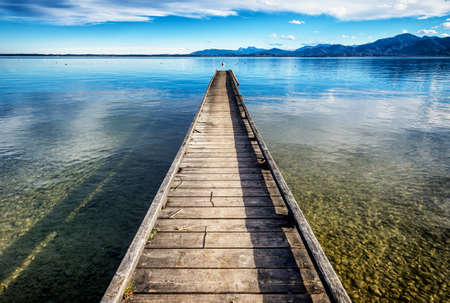 bigger picture: old wooden jetty at a lake Stock Photo