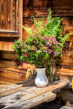 wildflowers at a log cabin photo