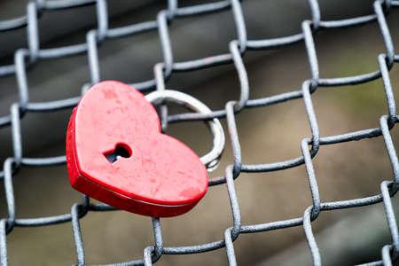 lock symbol: love padlock at a bridge Stock Photo
