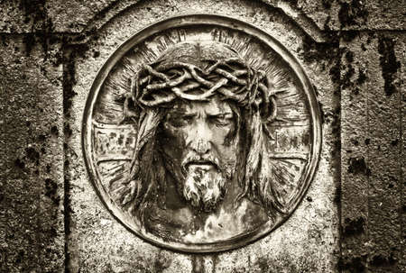 closeup: old jesus christ relief at a historic gravestone
