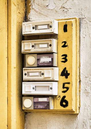rundown: rundown old bell buttons at a wall Stock Photo