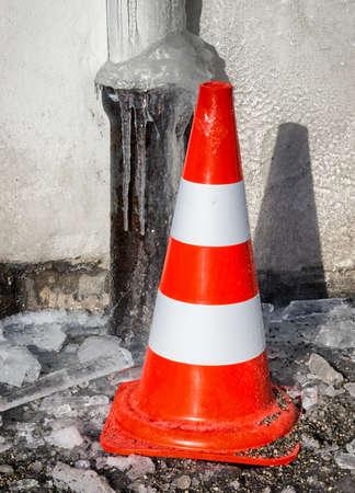 traffic cone: traffic cone at a sidewalk Stock Photo