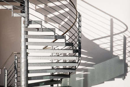 abstract white: spiral staircase at a modern building