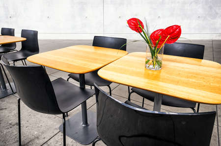 bigger picture: table and chairs at a cafeteria