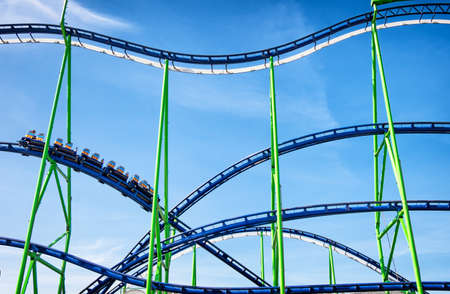 part of a roller coaster in front of blue sky Stockfoto