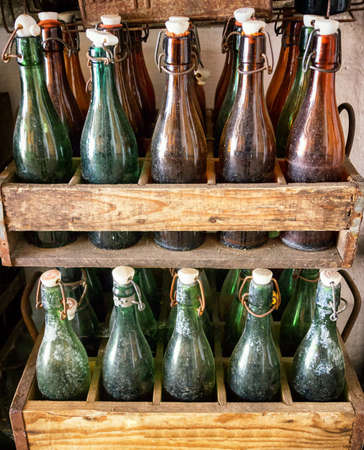 old bottles in wooden boxes photo