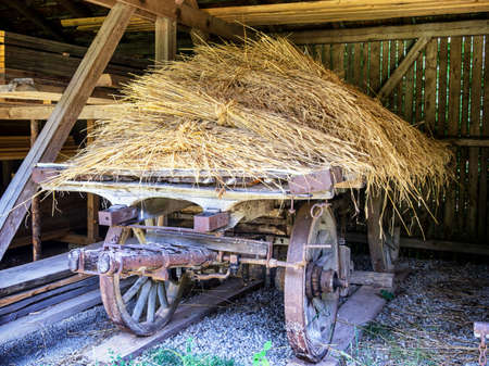 old wood farm wagon: old hay cart at a farm