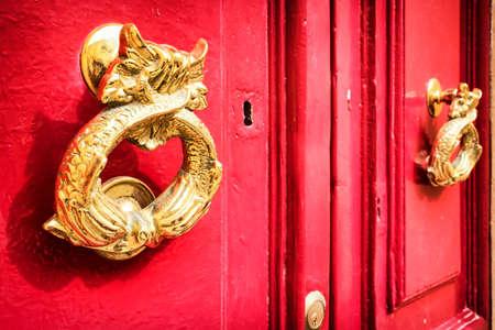 doorknocker: old doorknocker at a door Stock Photo