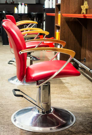 red chair: chairs at an old barber shop