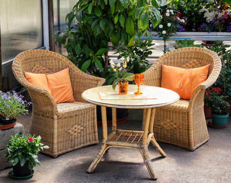 old furniture: basket chairs at a patio