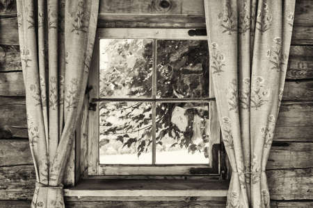 curtain: old curtains at a rundown window Stock Photo