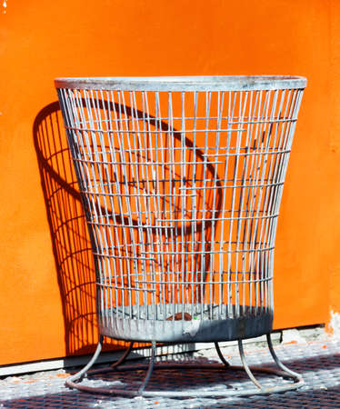 wastebasket: modern wastebasket at a sidewalk Stock Photo