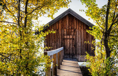 fishing cabin: old wooden boathouse at a lake