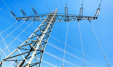electricity pylon: modern electricity pylon in front of blue sky Stock Photo