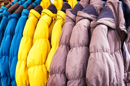 row of winter jackets - photo 免版税图像