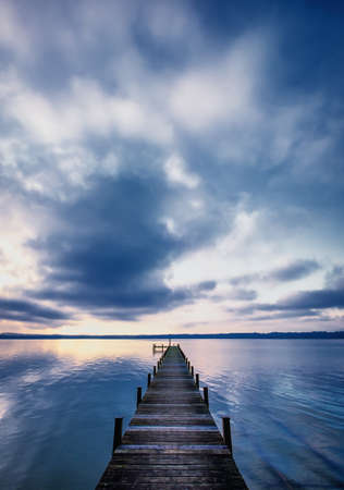 old wooden jetty at the chiemsee lake in bavaria