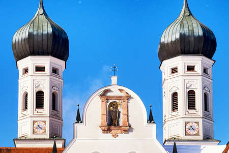 wayside: famous church in benediktbeuern - bavaria - and a historic wayside cross