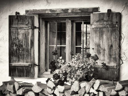 ranch house: old window and flowers at a historic building