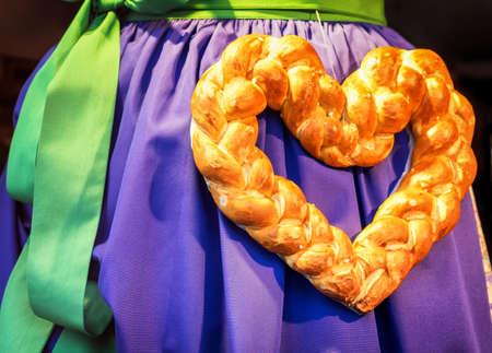 specific clothing: pretzel heart and typical dirndl