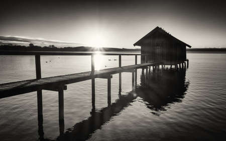 boathouse: old wooden boathouse at a lake