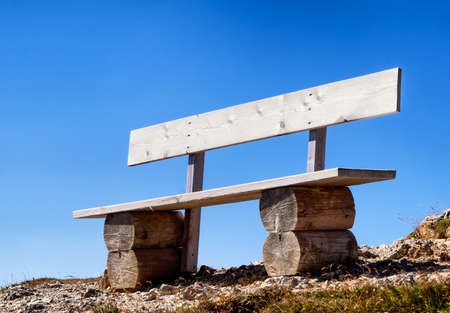 clear away: old park bench in front of blue sky