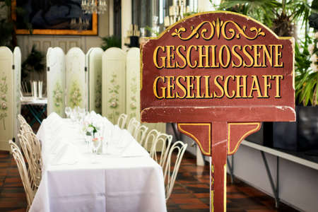 private party: old reserved sign at a restaurant in germany Stock Photo