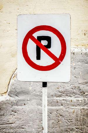 no parking sign: no parking sign at a garage