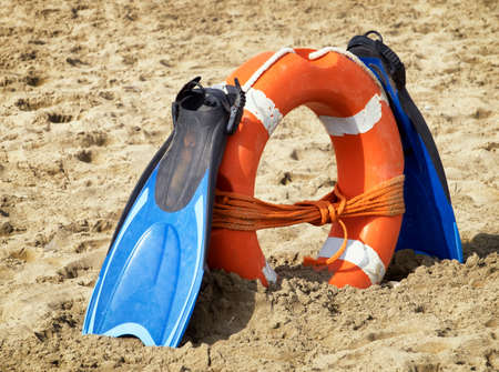 rescuer: flippers and lifebelt at a beach
