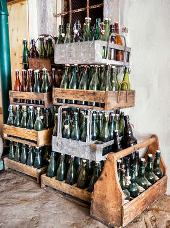 grunge bottle: old bottles in wooden boxes