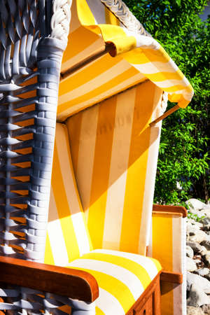 reclining chair: hooded beach chair at a back yard Stock Photo