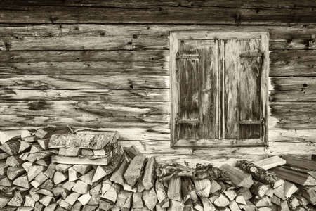 ranch house: old window at a farm - firewood