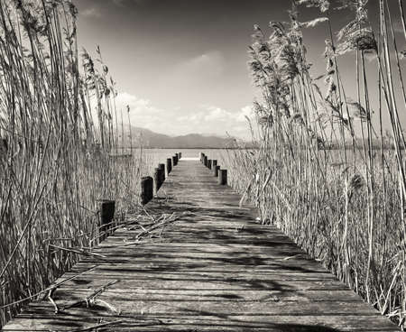 old fashioned sepia: old wooden jetty at a lake Stock Photo