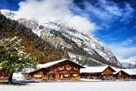 log cabin in snow: old farmhouse at the karwendel mountain - austria